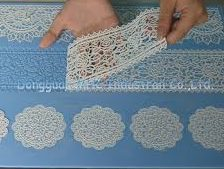 Removing edible lace from cake stenciling mold